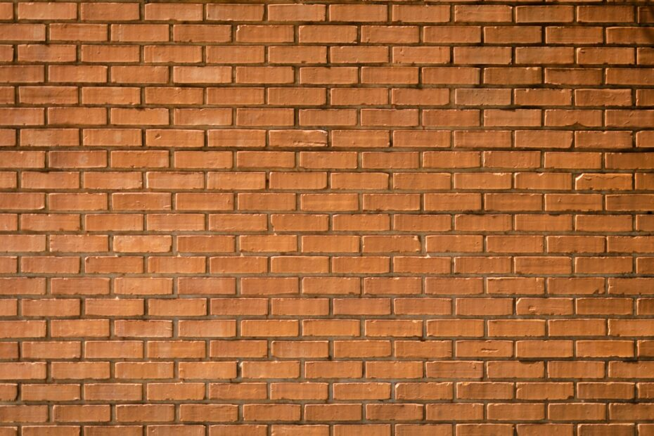 closeup photography of brown brick wall