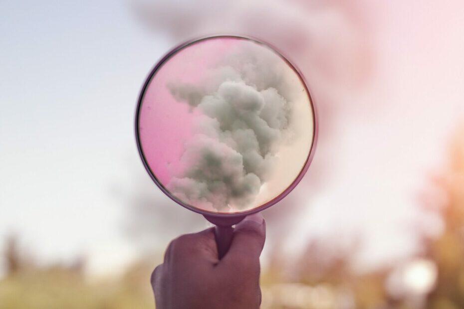 magnifying glass showing smoke