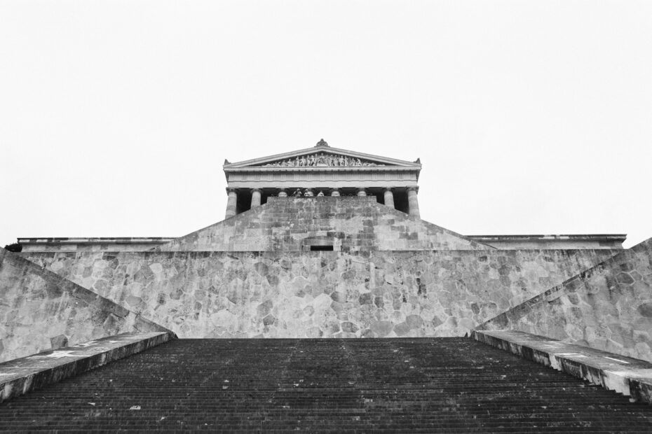 grayscale photography of concrete stairs near musuem